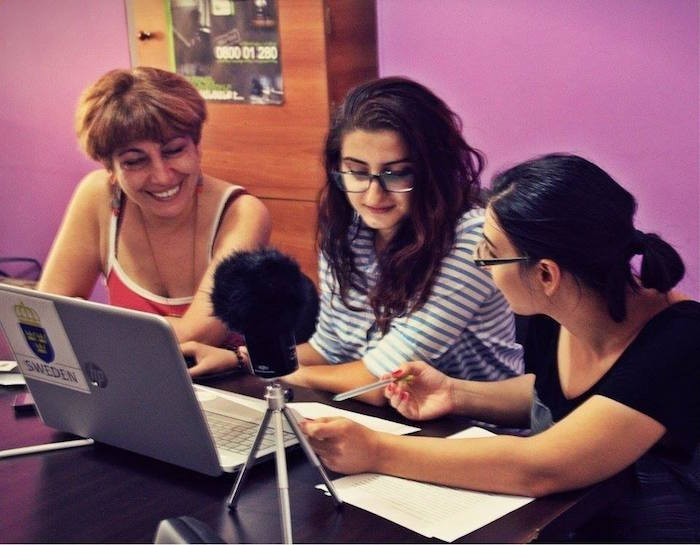 Lara (center) at work for Women's Voice Radio | Photo by: Petra Hultman
